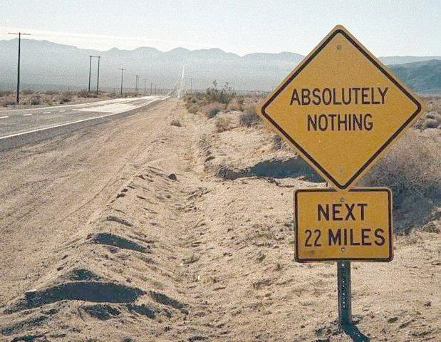 """""""Absolutely nothing"""" sign along a dirt road 