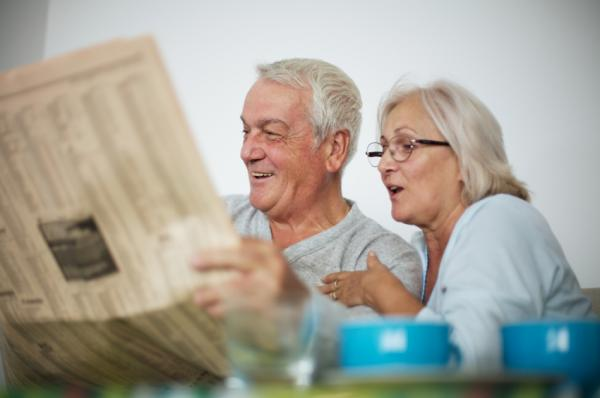 Elderly couple reading the paper | Cloud Surfing Media Digital Marketing